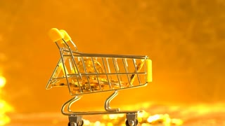 Bitcoin shopping concept with slow motion fallling coins on a shiny golden background