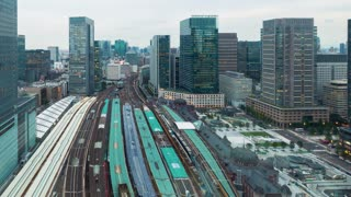 Day to night time-lapse above Tokyo Station in Japan