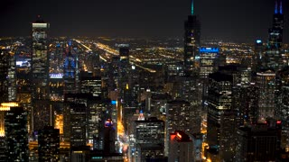 Downtown Chicago cityscape aerial view at night with focus rack