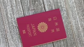 Japanese passport identification document book on a wooden table