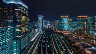 Night to day time-lapse above Tokyo Station in Japan