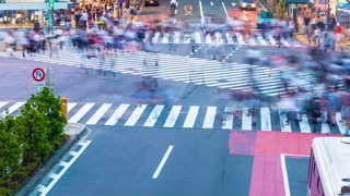 People cross the famous intersection in Shibuya, Tokyo, Japan one of the busiest crosswalks in the world.