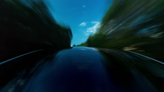 POV time-lapse of a white luxury vehicle driving down the road