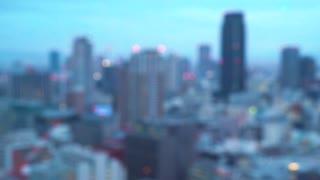 Rack focus of large cityscape in Osaka, Japan