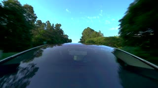 RALEIGH - JUNE 26, 2018: New all electric Tesla Model 3 driving down the road with a view from the glass roof.
