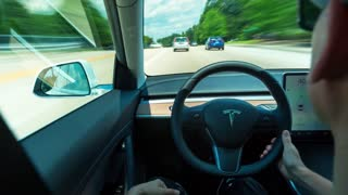 RALEIGH, NC USA, JUNE 22, 2018: Person driving a new Tesla Model 3 in autopilot. The model 3 is set to be the Tesla's first mass market electric vehicle