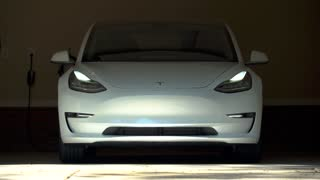 RALEIGH, USA, JULY 03, 2018: A brand new white Tesla Model 3. The model 3 is set to be the Tesla's first mass market electric vehicle