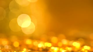Ripple cryptocurrency coin illuminated on a shiny golden background