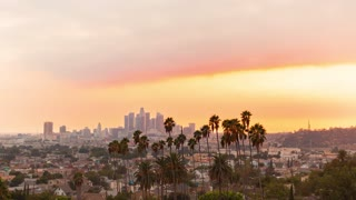 Sunset time-lapse of Downtown Los Angeles with palm trees