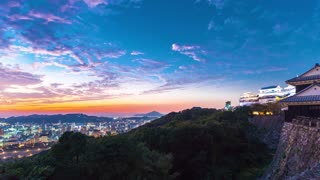 Sunset time-lapse of Matsuyama Castle, in Japan