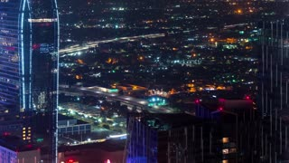 Time-lapse above Downtown Los Angeles at night looking at the expressway