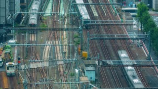 Time-lapse of a busy train station rail yard in Marunouchi, Tokyo, Japan