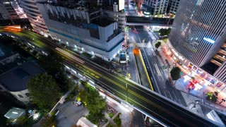 Time-lapse of a highway and railway in Ginza Tokyo at night
