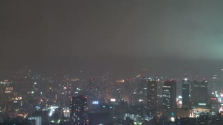 Time-lapse of a rain storm over Osaka at night