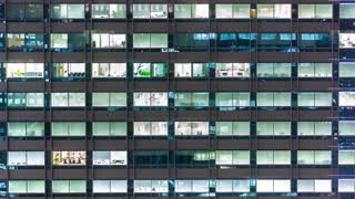 Time-lapse of an office building illuminated at night in Tokyo, Japan