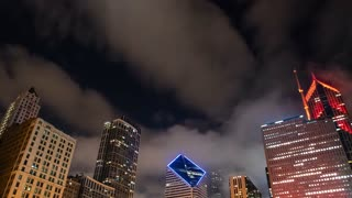 Time-lapse of Chicago skyscrapers with passing clouds