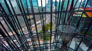 Time-lapse of Ginza, Tokyo as seen through the metal facade of a shopping mall