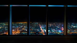 Time-lapse of Osaka at night from inside looking out at the city