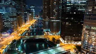 Time-lapse of the Chicago River with traffic and boats at night