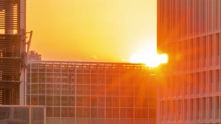 Time-lapse of the sun setting behind skyscrapers in Tokyo, Japan