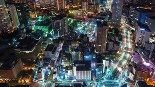 Time-lapse of traffic moving through Toranomon, Tokyo, Japan at night