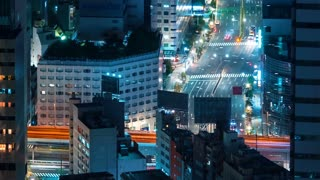 Time-lapse of traffic moving through Toranomon, Tokyo, Japan at night