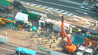 TOKYO, JAPAN - SEP, 25 2017: Construction workers complete morning stretches in Shibuya, Japan