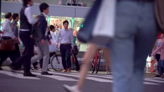TOKYO, JAPAN - SEP, 25 2017: People cross the famous intersection in Shibuya, Tokyo, Japan one of the busiest crosswalks in the world