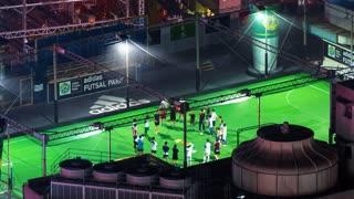 TOKYO, JAPAN - SEP, 25 2017: People play soccer in atop a skyscraper in Shibuya, Tokyo, Japan in time-lapse