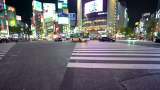TOKYO, JAPAN - SEP, 25 2017: Traffic crosses the famous intersection in Shibuya, Tokyo, Japan one of the busiest crosswalks in the world