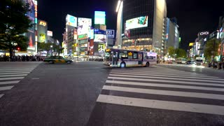TOKYO, JAPAN - SEP, 25 2017: Traffic crosses the famous intersection in Shibuya, Tokyo, Japan one of the busiest crosswalks in the world.