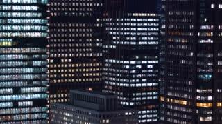 Tokyo skyscraper office buildings illuminated at night
