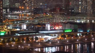 View of Odaiba, Tokyo at night with ferris wheel