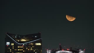 View of the moon rising above the Tokyo skyline