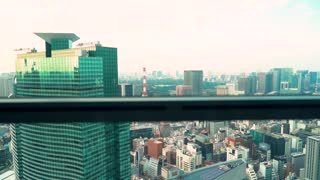 View of Tokyo from an elevator in a a skyscraper
