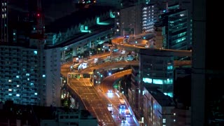 View of Tokyo highways at night by Tokyo Bay