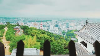 View of a Japanese city from an ancient castle window