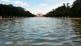 WASHINGTON DC- JULY 4, 2016: The Lincoln memorial on the national mall with the reflecting pool in the foreground