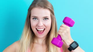 Young woman with doing a variety of fitness related poses