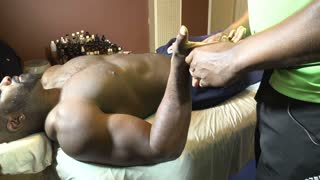 Black male hand and arm massage