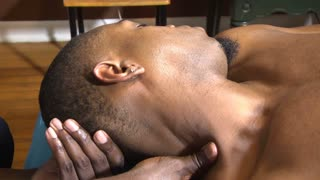 Black male neck massage