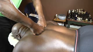 Black male upper back massage