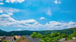 4K Cloud Timelapse Over Village