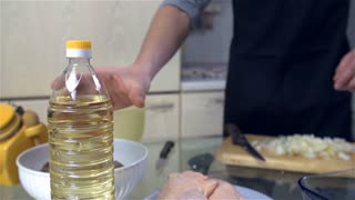 Adding Oil To Glass Tray For Chicken