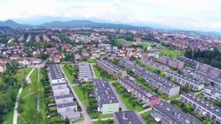Aerial Flight over Ljubljana with buildings in rows. Aerial fly over settlement buildings placed in rows. Big neighborhood.