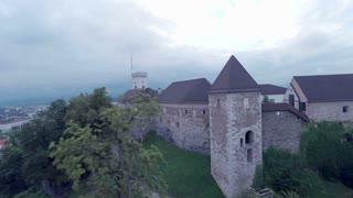 Aerial flying over Ljubljana castle in bad weather