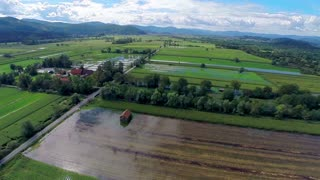 Aerial landscape shot of flooded farm on a sunny day