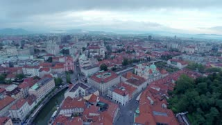 Aerial panning from city center to Ljubljana castle