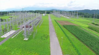 Aerial Power station distributor electric lines. Flying next to power distribution complex, supplying nearby city with electricity.