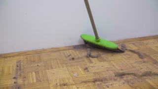 Big pile of dust close up. Sweeping home floor with a lot of dirty dust in slow motion.